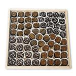 66 artisanal chocolate truffles on a glass platter from shiva.com. Kosher