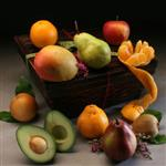 5lbs. of seasonal fresh fruit in a gift box with fresh leaves and flowers from shiva.com.