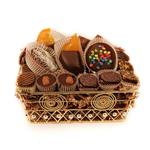 Handmade truffles, ganaches with chocolate dipped fruit and more on a gold wire tray from shiva.com. Kosher
