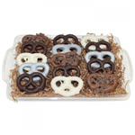 15 double dipped chocolate pretzels on a glass platter from shiva.com. Kosher